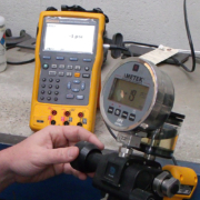 Tech Calibrating a Pressure Gage