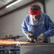 Technician using a grinder